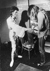 Make-up artist Pierre La Roche prepares English singer David Bowie for a performance as Aladdin Sane, 1973.