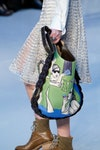 Image may contain: Clothing, Apparel, Human, Person, and Bag