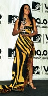 Image may contain: Aaliyah, Human, Person, Fashion, and Premiere