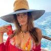 Image may contain: Clothing, Apparel, Hat, Human, Person, Natalia Estrada, and Sun Hat